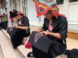 Black Thai women carefully make their Pieus.