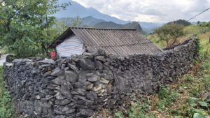 The Mong fence their houses with stone walls
